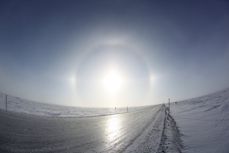 Sundogs in tundra along a trans-Alaska pipeline, during mid-winter