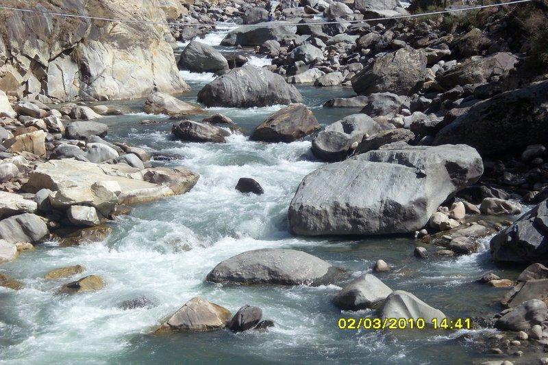 A Natural Phenomenon: Hot water Spring entering in cold water