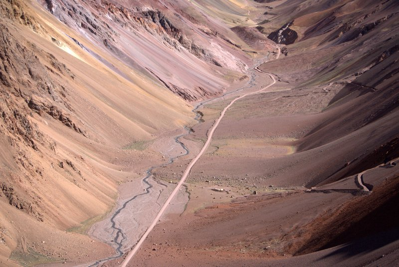 Fluvial landslope dynamics in a high mountain valley with an international road