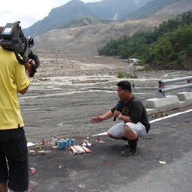 ATV repoter overlooking the Shiao-Lin landslide which buried almost 500 residents
