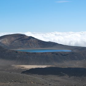 Volcanic lake in clouds