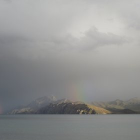 Double rainbow over a Tibetan Plateau lake