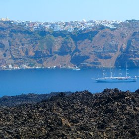 Lava fields on Nea Kameni with Fira, Santorini, in the background