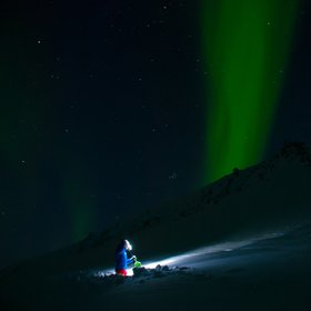 Snow stability testing under Northern Lights