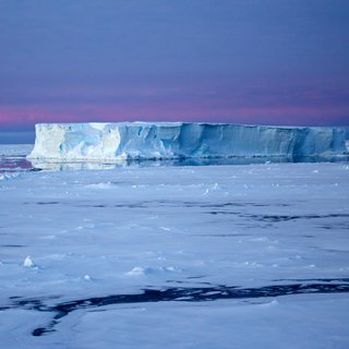 Table iceberg at night in the Antarctic