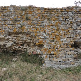 Ancient fortification wall covered in lichens