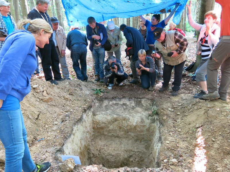 loving soil. Polish soil scientists in front of a soil profile