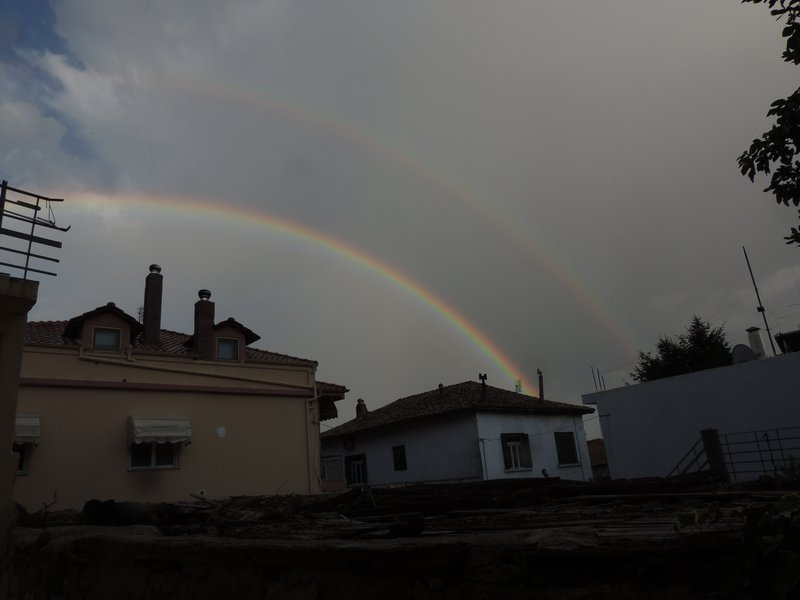 Double rainbow with Alexander's band in-between