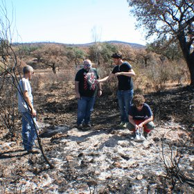 Soil scientists in action: Arturo, Antonio, Adrián and Lorena sampling a burnt soil