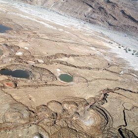 Sinkhole sideview from an aerial survey at the Dead Sea shoreline