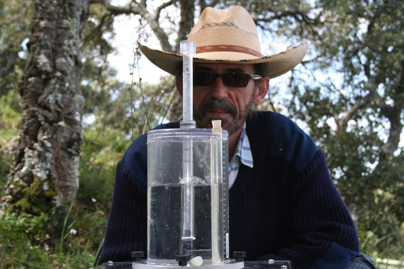 Soil scientists in action: Arturo (and his hat) performing a rainfall simulation experiment