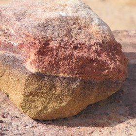 A stone with colored layers of sand from the Jurassic period