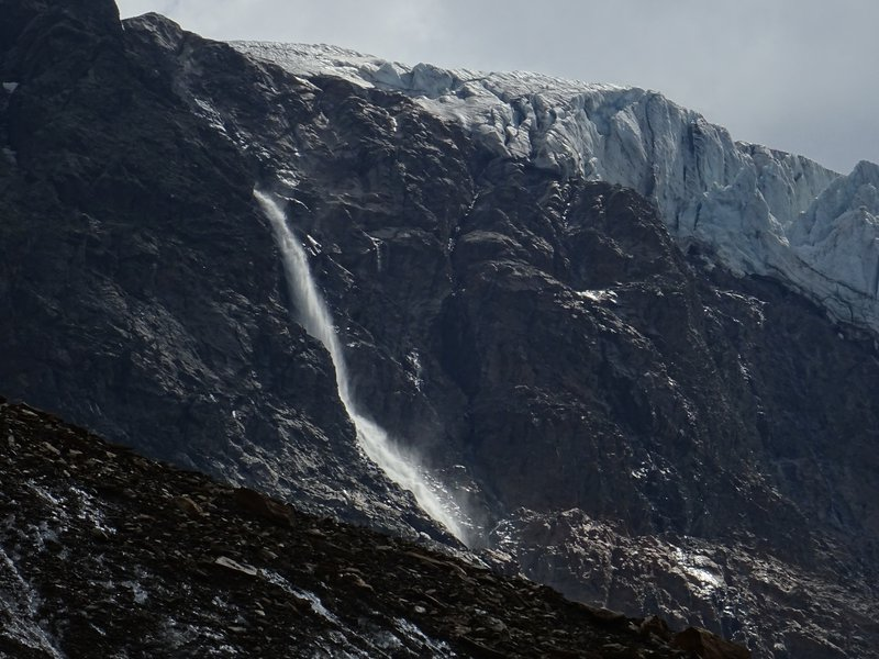 Glacial waterfall from hanging glacier