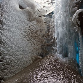Volcanic ash frozen within a glacier mill