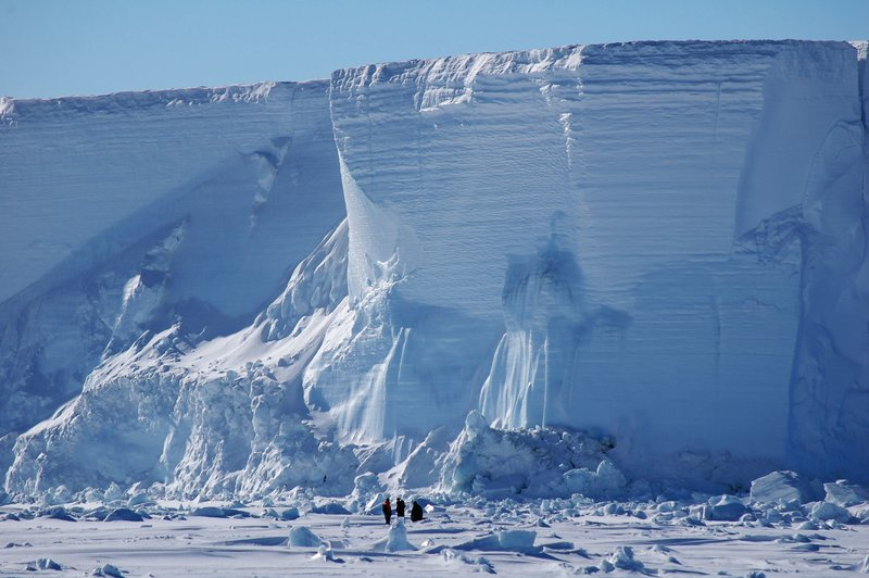 Dwarfed by a grounded iceberg