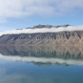 Amazing reflection of Spitsbergen Wijdefjorden in the Svalbard, the Arctic