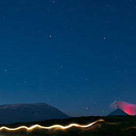 Eruption of the Kluchevskaya Sopka glowing in the night.