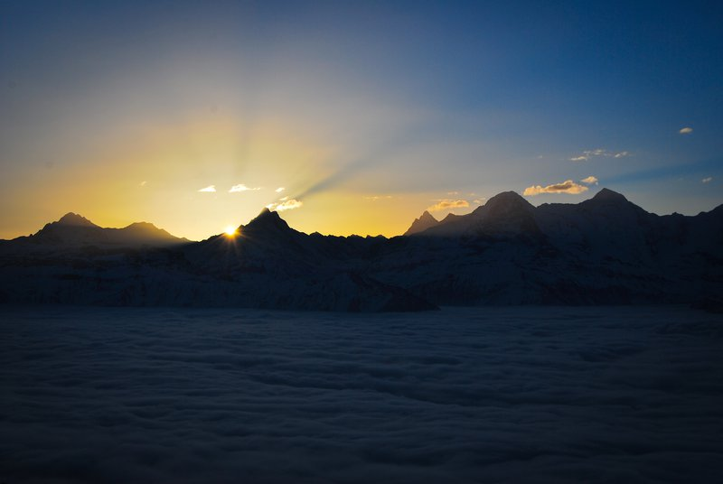 sunrise over the Bernese alps with high fog in the valley