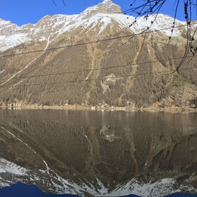 Lake mirroring effect at Ceresole Reale, in Gran Paradiso Park.