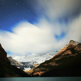 Night sky over the emerald glacier Lake