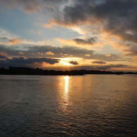 Sunset Over Water Surface stock images
