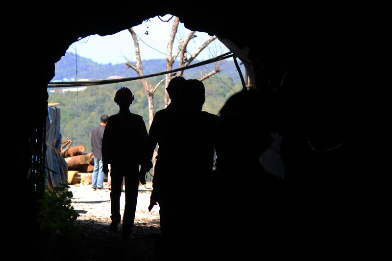 Workers exiting a mine shaft, Bawsaing, Myanmar