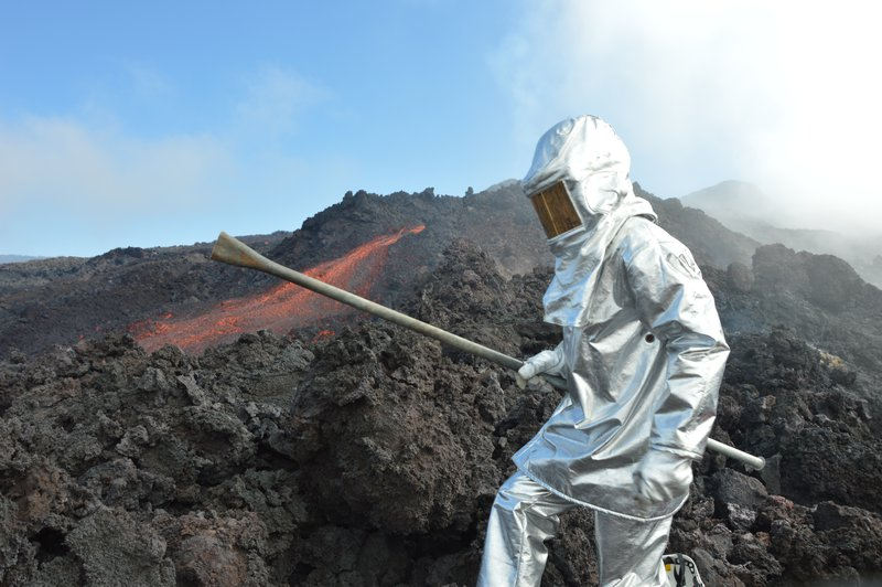 Scientist and lava flows.