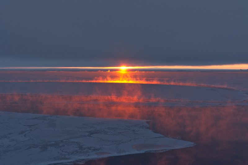 Sunset sea smoke, Antarctica