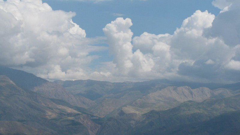 The combination of mountain and cloud in Shah Alborz Mountain Range - Alborz Mountains - Qazvin - Iran