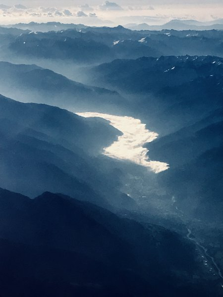 """""""River"""" of clouds in an Alpine valley"""