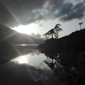 Sun peaking through the clouds at the Killary Fjord