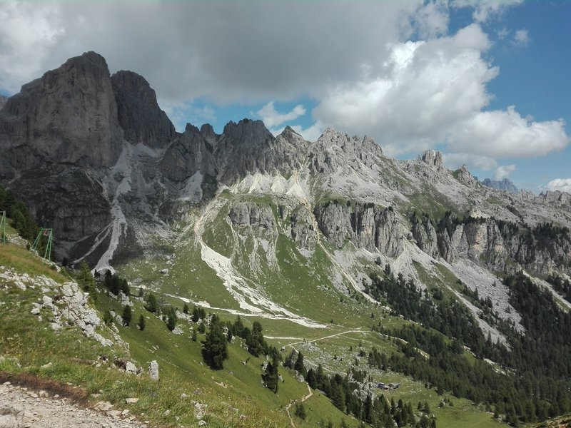 Ragged peaks and green valleys in a scarred landscape