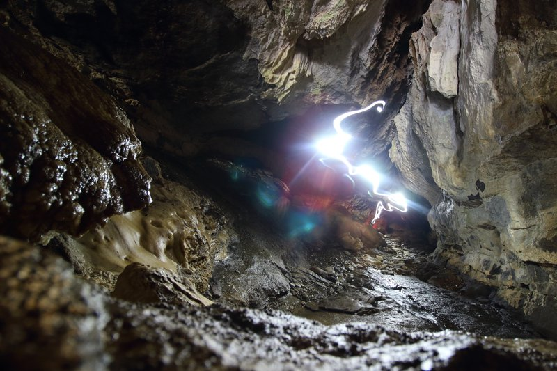 Walking light in the Luxmore Caves