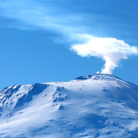 Plume of steam rising from the crater of Mount Erebus, Antarctica